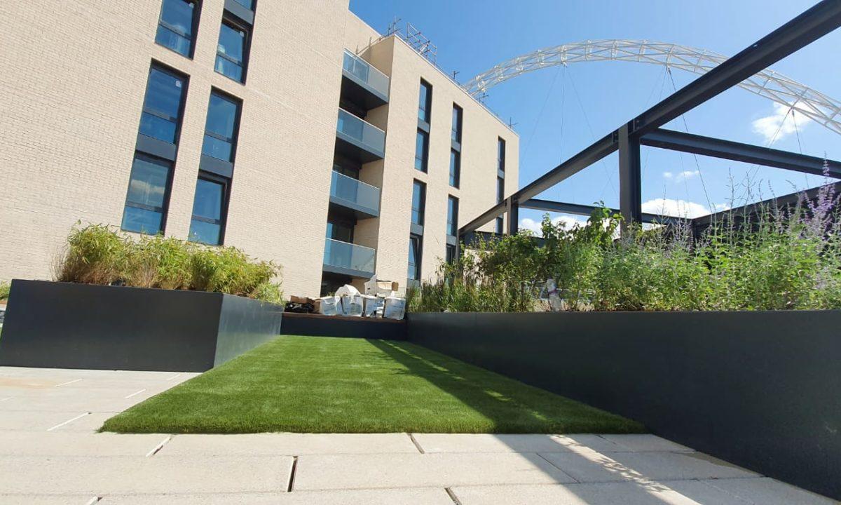 Commercial artificial grass installation after shot