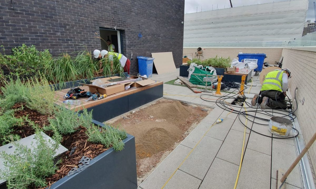Commercial artificial grass installation in process